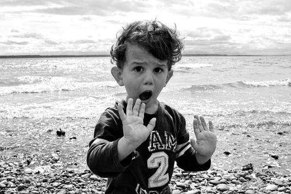 Boy shouting on beach